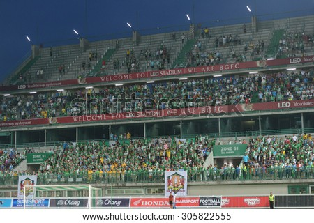 PATHUMTHANI, THAILAND- AUG12: BGFC fans cheer in action during Thai Premier League 2015 between BGFC and BuriramUtd at Leo Stadium on August 12, 2015 in Thailand. - stock photo