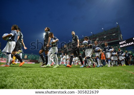 PATHUMTHANI, THAILAND- AUG12: Players walking in to the field in action during Thai Premier League 2015 between BGFC and BuriramUtd at Leo Stadium on August 12, 2015 in Thailand. - stock photo