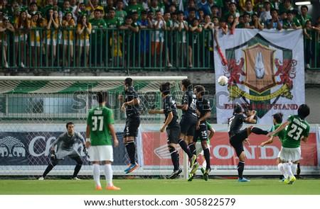 PATHUMTHANI, THAILAND- AUG12: Siwarak Tedsungnoen goalkeeper of BuriramUtd in action during Thai Premier League 2015 between BGFC and BuriramUtd at Leo Stadium on August 12, 2015 in Thailand. - stock photo