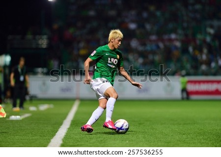 PATHUMTHANI,THAILAND-FEB 28:Goshi Okubo(g) of BGFC in action during geam Thai premier League 2015 between Bangkok Glass FC and Muangthong UTD at LeoStadium on February 28, 2015 in Thailand - stock photo