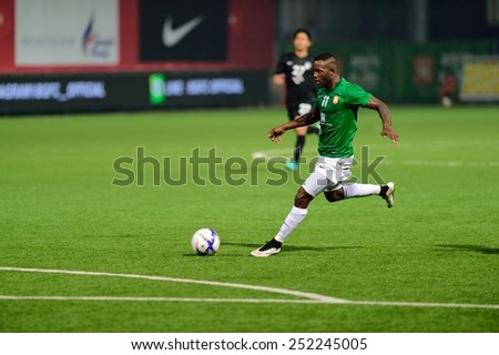 PATHUMTHANI,THAILAND-FEB2015:Lazarus Kaimbi(g) of BGFC in action during geam AFC Champions League 2015 : BangkokGlassFC(Th) 3-0 JohorDarulTakzim(My) at LeoStadium on February 10, 2015 in Thailand - stock photo