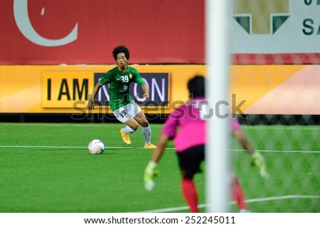 PATHUMTHANI,THAILAND-FEB2015:Tanasith Siripala(g) of BGFC in action during geam AFC Champions League 2015 : BangkokGlassFC(Th) 3-0 JohorDarulTakzim(My) at LeoStadium on February 10, 2015 in Thailand - stock photo