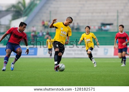 PATHUMTHANI,THAILAND- JAN 24 : Leandro Dos Santos of Bangkok Glass FC(No.9) in action during a friendly match between Bangkok Glass FC and Singapore Armed Forces FC at Leo Stadium on Jan 24, 2013 in Pathumthani, Thailand. - stock photo