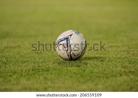 PATHUMTHANI THAILAND-Jul19:Football on lawn during the Thai Premier League between Police United and Sisaket FC at Thammasat Stadium on July 19,2014,Thailand - stock photo