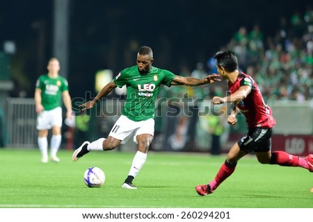 PATHUMTHANI,THAILAND, MARCH 2015 :Lazarus Kaimbi(G) of BGFC in action during geam Thai premier League 2015 between Bangkok Glass FC and Bangkok UTD at LeoStadium on MARCH 11, 2015 in Thailand - stock photo