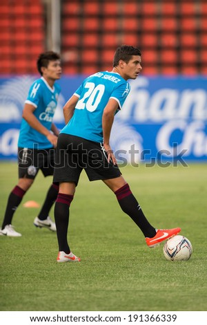 PATHUMTHANI THAILAND-MAY 05:Sergio Suarez of Police Utd.in action during a training ahead the Thai Premier League match between Police Utd.and Songkhla Utd.at Thammasat Stadium on May 05,2014,Thailand