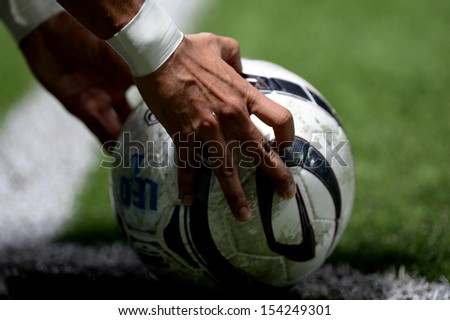 PATHUMTHANI,THAILAND SEP14 :Details of ball during in Thai premier League between Bangkok Glass FC and Pattaya United at LeoStadium on september14, 2013 in Thailand  - stock photo