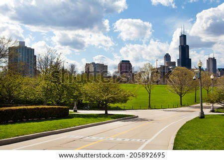 Pathway along lake front with Chicago skyline in background