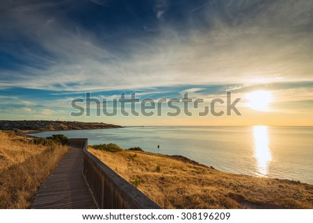 Pathway along the coast at sunset