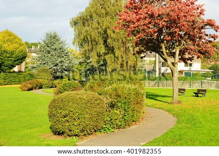 Pathway and Trees in a Beautiful Green Park - stock photo
