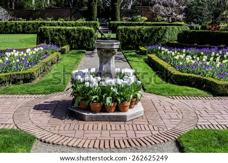 Pathway in a Beautiful Landscape English Garden with Sundial - stock photo