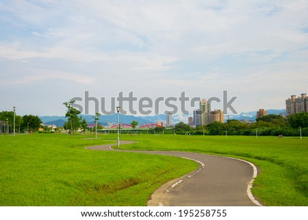 Pathway in a Lush Green Park - stock photo