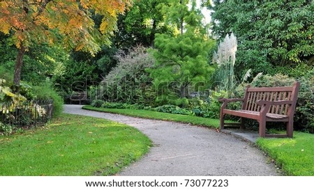 Pathway in a Peaceful Green Park - stock photo