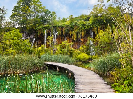 Pathway in Plitvice lakes park at Croatia - travel background - stock photo