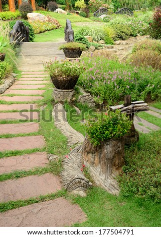 pathway in the garden, beautiful landscaping of gardening - stock photo
