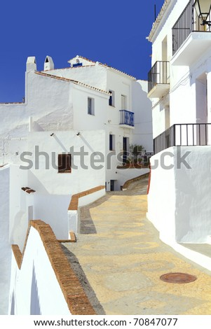 Pathway leading through the village of Frigiliana in Spain on a hot summers day