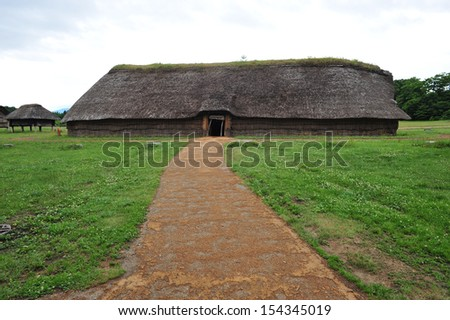 Pathway to hut of ancient human tribe, north of Japan - stock photo