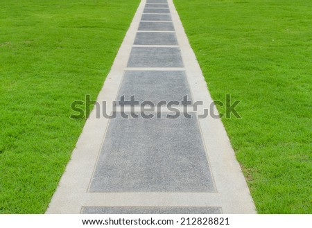 pathway with green grass in park.