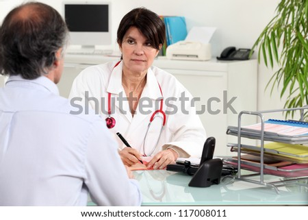 Patient and general practitioner - stock photo