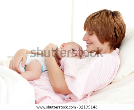 Patient and newborn baby in hospital - stock photo