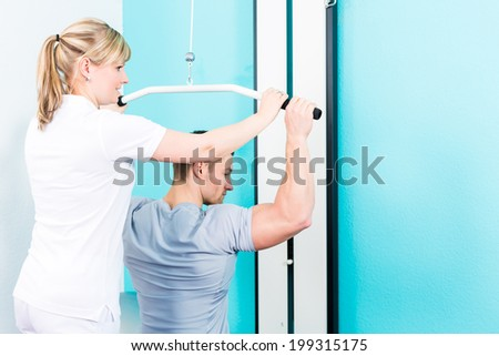 Patient at the physiotherapy doing physical exercises with therapist in sport rehabilitation - stock photo