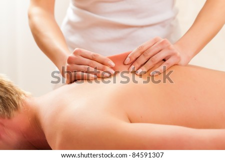 Patient at the physiotherapy gets massage or lymphatic drainage - stock photo