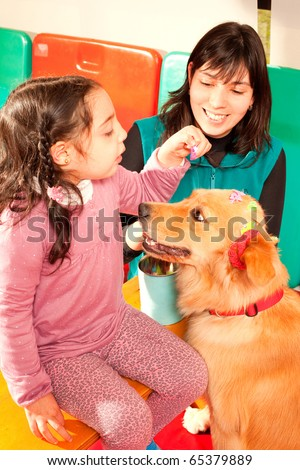 Patient been treated with the assistance of a trained dog - stock photo