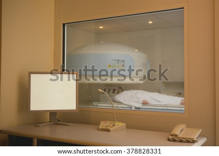 Patient being scanned and diagnosed on a computed tomography - stock photo