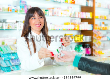 Patient giving a prescription to a smiling pharmacist