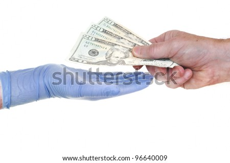 Patient Giving Doctor Money Representing Rising Healthcare Costs - stock photo