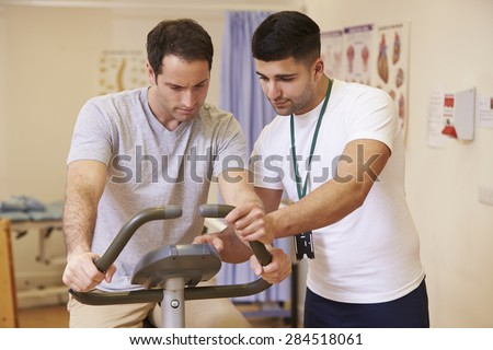 Patient Having Physiotherapy On Trampoline In Hospital - stock photo