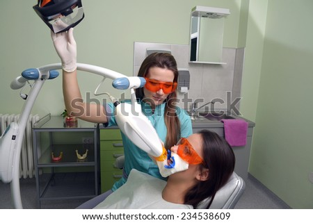 Patient in a dental treatment  - stock photo