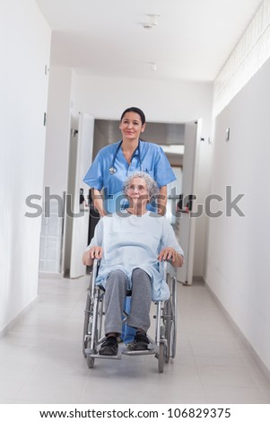 Patient in a wheelchair in hospital ward