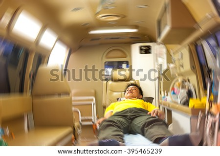 patient in  ambulance is going major hospitals - stock photo