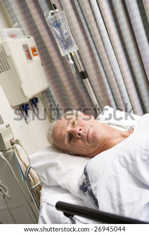 Patient In Hospital Bed - stock photo
