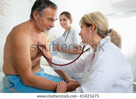 Patient is being observed by doctor - stock photo