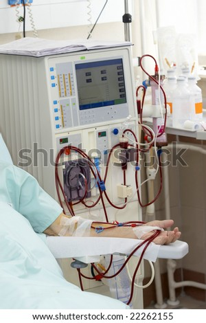 patient monitored by electronic sphygmomanometer during dialysis session