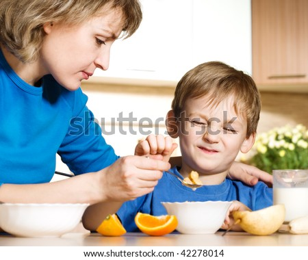 Patient mother and naughty son - stock photo