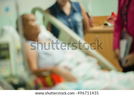 Patient on bed in room hospital blur background