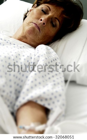 Patient on hospital bed - stock photo