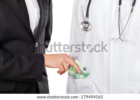 Patient paying for medical services with euro - stock photo