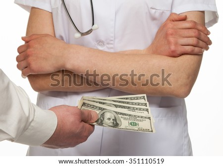 Patient paying money for medical service, white background - stock photo