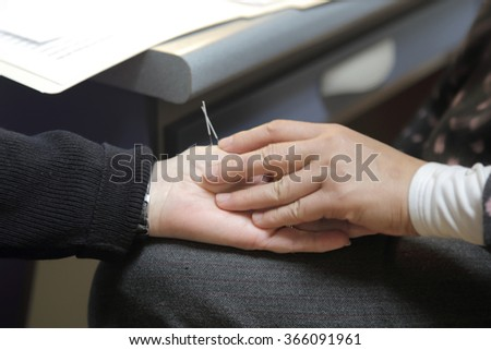 Patient receiving acupuncture needles. - stock photo