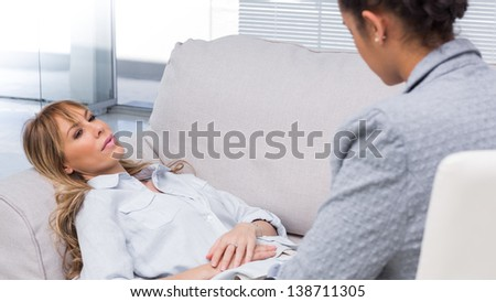 Patient telling her problems to therapist - stock photo