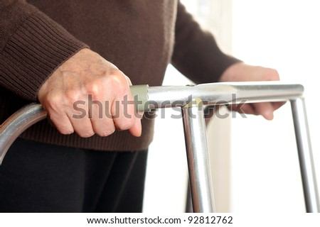 Patient using a walker - stock photo