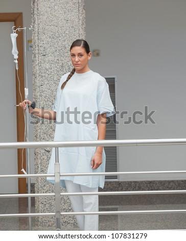Patient walking in the corridor in hospital - stock photo