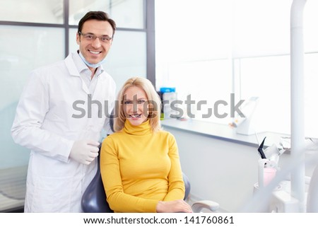 Patient with a dentist in clinic