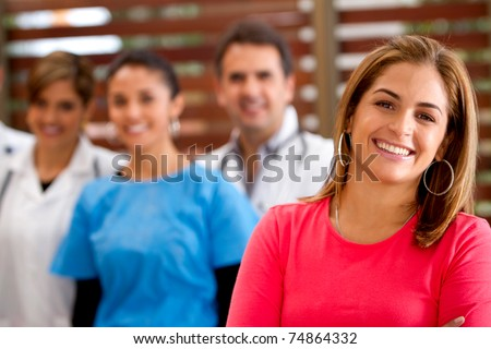 Patient with a group of doctors at the hospital - stock photo