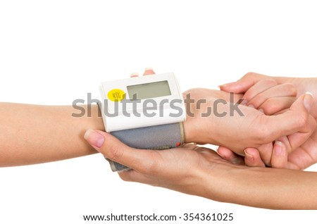 Patients arm with glucose measure meter around wrist and doctors hands holding supporting. - stock photo