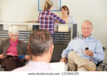 Patients In Doctor's Waiting Room - stock photo